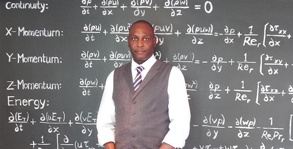 Professeur de mathématiques à l'USB, A. Bass Bagayogo, travaillant sur les équations de Navier-Stokes.