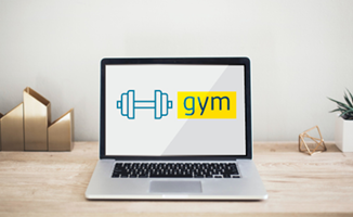 A laptop computer on a desk showing Gym on its screen.